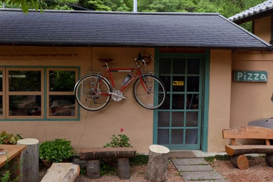 Clear sign of a bike friendly pizza place.  It also served the best pizza I've had in Japan.